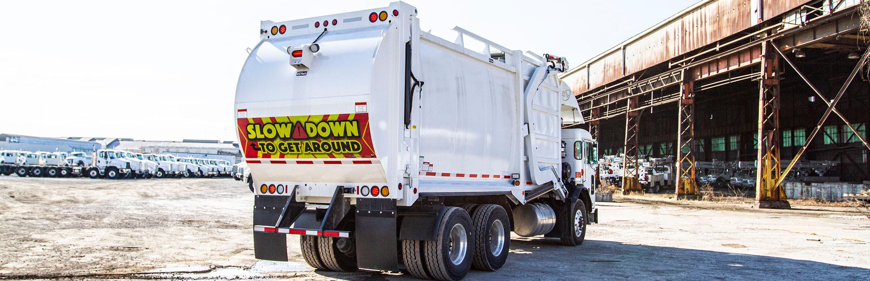 Front-End Loader (FEL) - E-Z Pack Hercules Trash Truck